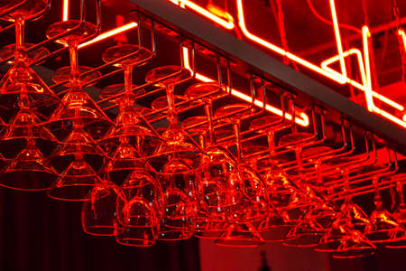 BARWARE: Clean stemware hanging on the rack in the bar