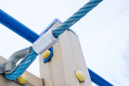 cleat: A detailed closeup macro of a rope mooring line fastened to a cleat.