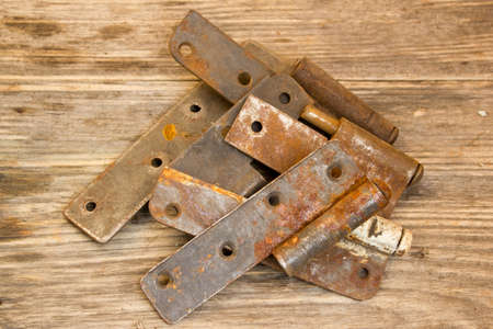 hinge joint: metal door hinge on a grungy wooden background Stock Photo