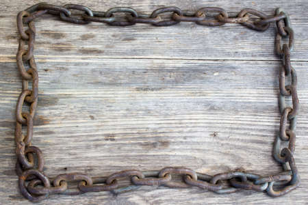 servitude: Metal chain on nice old wooden background, Copy space to right. Stock Photo