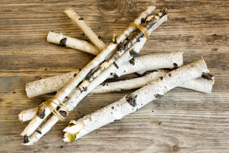 birchbark: Birch tree trunks and branches on natural wood background