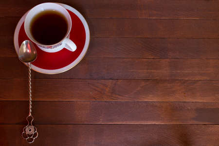 Closeup of cup of tea on wooden background with copy space Standard-Bild