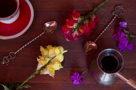 cezve: cezve, cup, spoon on a dark wood background