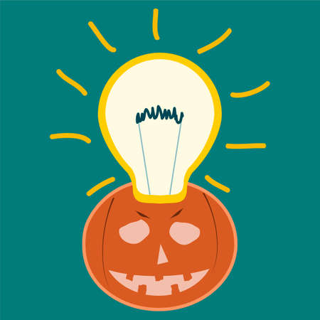 filament: Light bulb filament and a smiling pumpkin. Halloween, a new idea for the holiday.