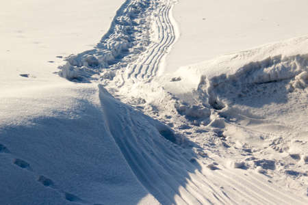 wintery day: Winter trail, the road in the snow Stock Photo