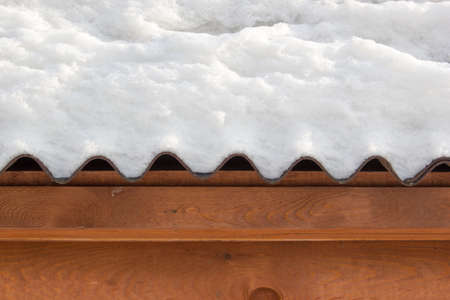 The snow on the roof of a wooden house Stock Photo