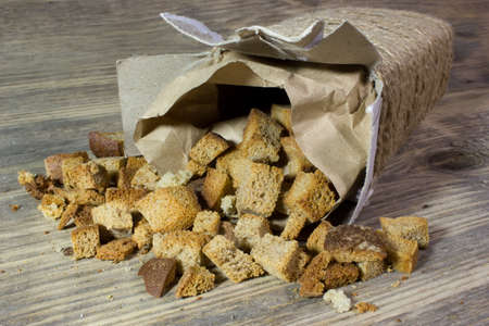 croutons: Homemade croutons on wooden background Stock Photo
