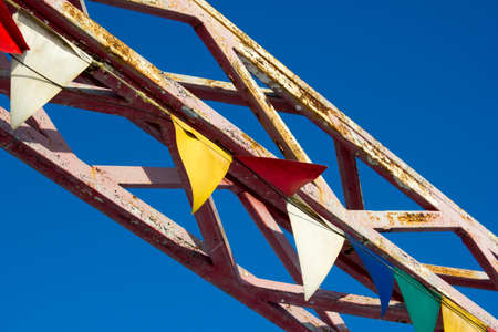 prefabricated buildings: Colored metal construction on blue sky background