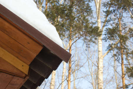 cedar shakes: The snow on the roof of a wooden house Stock Photo
