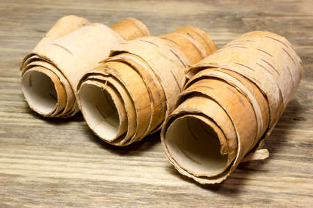convolute: Rolls of birch Bark on wooden