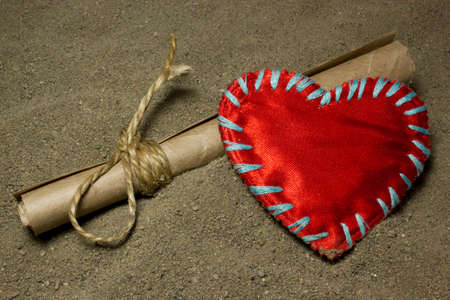 castaway: Message and red heart love on the sand.