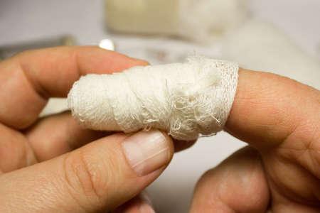 bandaged: A bandaged index finger. Closeup. Stock Photo