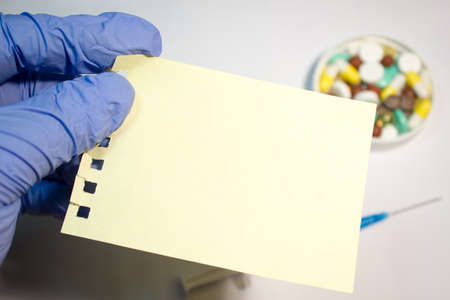 medical gloves: The sheet of paper in hands in medical gloves Stock Photo