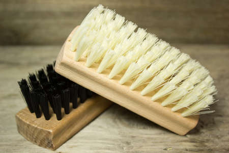 accessories horse: Clothes brush on wooden background Stock Photo