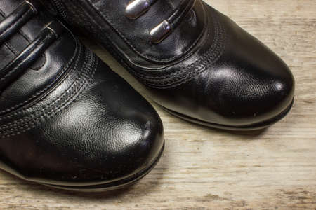 black boots: Black boots on wooden background