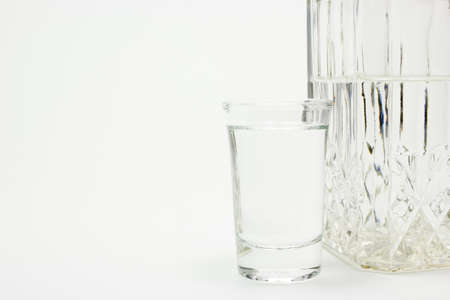 carafe: Carafe and glass of vodka on white