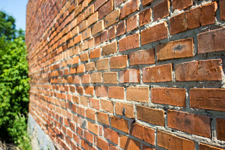 Old destroyed wall from a red brick Stock Photo