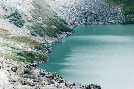 Beautiful mountain lake in the rocky summer day Stock Photo