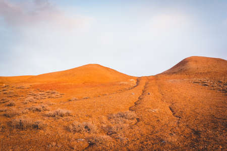 Yellow and red hills in hot desert. Steppe mountains Stock fotó
