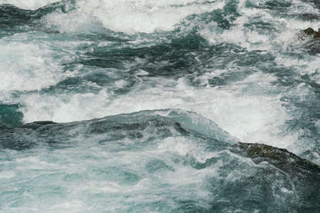 Blue bubbling water of mountain river. Ocean tide of  turquoise sea Stok Fotoğraf