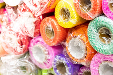 Rolls of colored wrapping paper on counter of store. Holiday and scrapbooking goods
