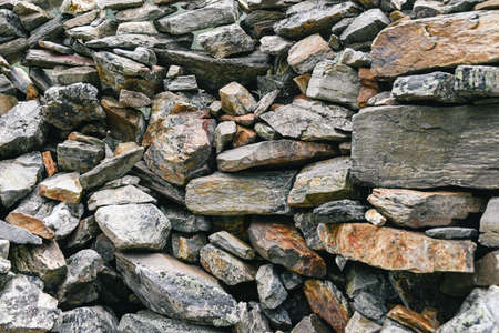 Dump of stones for construction. Stone quarry with boulders. Mountain moraine,  barrier to tourist.