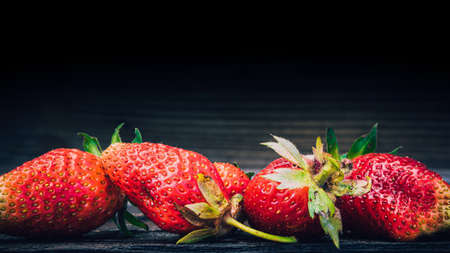 Strawberry berry on wooden table. Fresh berries for summer diet.