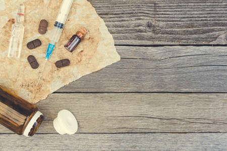Ampoules and pills on table. Patient treatment in hospital