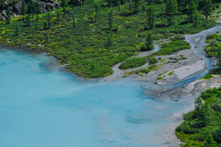 Blue lake in valley. Turquoise river in rocks. Hiking in mountains in Altai nature