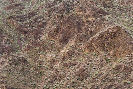 Red sandy slopes of canyon. Corrosion the soil after drought and global warming. Lack of water in stone desert
