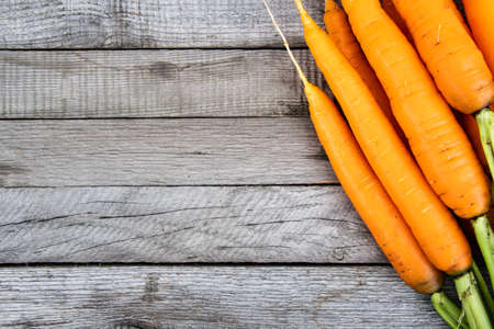 fresh carrots on wooden table, cooking vegetarian dishes, growing vegetables farm Zdjęcie Seryjne