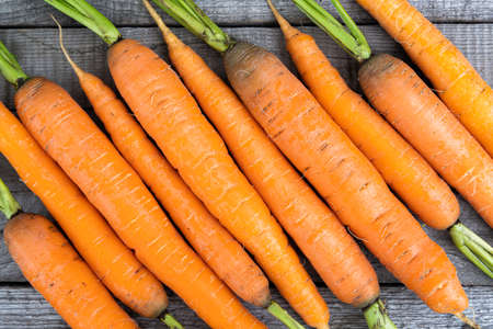 fresh carrots on wooden table, cooking vegetarian dishes, growing vegetables farm Imagens
