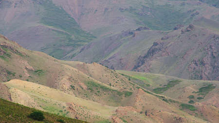gentle red hills, journey through mountain valley, pastures for animals, soil erosion in arid steppe