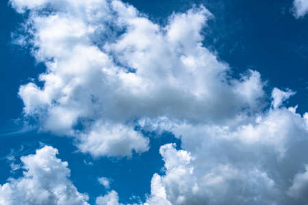 Picturesque clouds in blue sky on sunny day