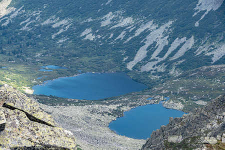 Spectacular view of blue lake in mountain valley Standard-Bild
