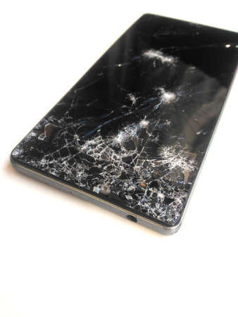 broken iPhone phone, broken iPhone, cracked black smartphone on a white background