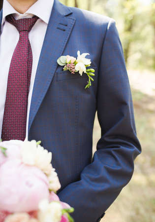 Boutonniere groom in a blue suit