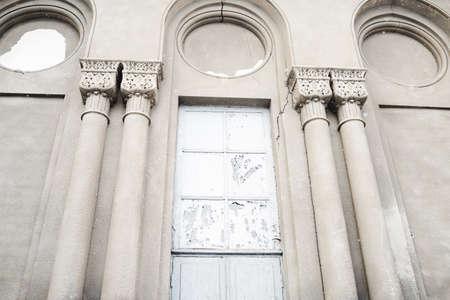 Classic Facade. Vintage old building facade. Aged classic building facade with windows. Vintage building facade wall. Classic european architecture. Postcard wallpaper. Luxury estate concept.