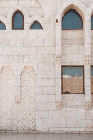 mustafa: View of the tower of the ancient mosque. Mosque entrance ornament. Islamic ornaments on wall. Arab symbols. Al Mustafa Mosque Sharm El Sheikh. Ancient wall