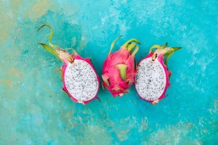 Pitahaya on a turquoise background. Exotic fruits. Copyspace Stock Photo