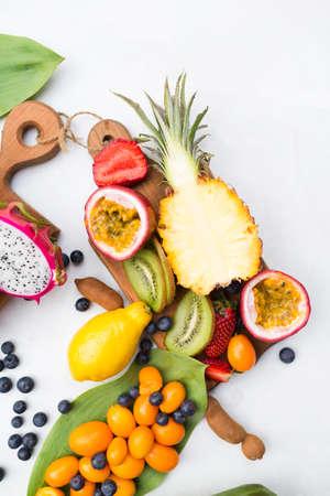 tamarindo: Exotic fruits. Summer photo concept. Mango. Papaya. A pineapple. Avocado. Kiwi. Exotic fruits. Mango. Papaya. A pineapple.  Kiwi. Pitahaya. Kumhvat. Copyspase. Fresh fruits