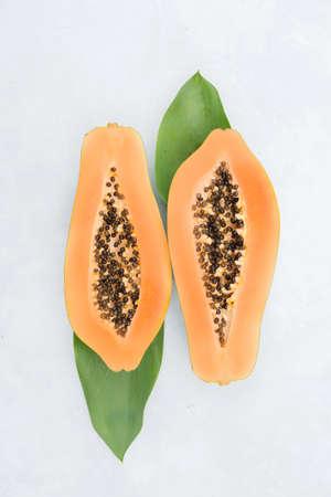 Papaya on a  light background. Exotic fruits. Copyspace Stock Photo