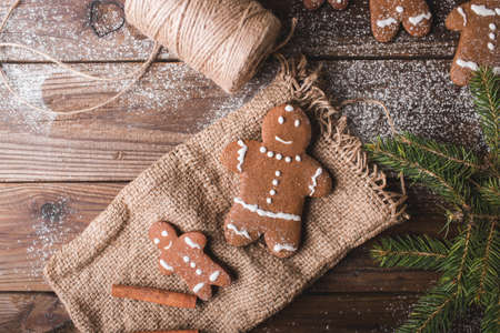 Gingerbread man on a wooden background and sacking on wooden background Stock Photo