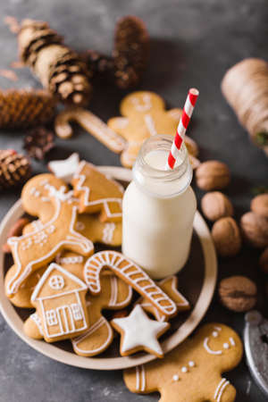 Milk and cookies. Gingerbread  cookies on a gray background.  Christmas cookies.  Ginger men
