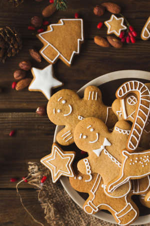 Ginger men on a wooden background. Gingerbread. Christmas cookies Stock Photo - 88309613