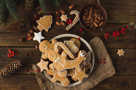 Ginger men on a wooden background. Gingerbread. Christmas cookies