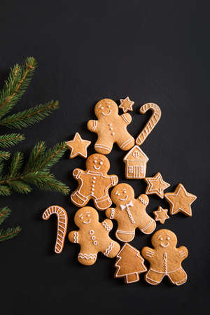 Ginger men with glaze on a black background . Gingerbread. Christmas cookies.