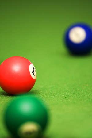 poolball: Three pool balls on a pool table