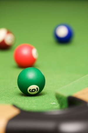 poolball: Four pool balls on a green filt covered pool table