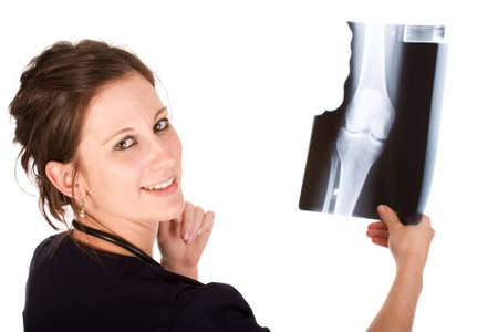 Young attractive female doctor holding a knee x-ray photo